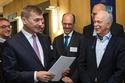 VP Ansip receiving a reposrt from Prof Mlynek