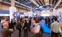 Panoramic view of an exhibition area full of visitors