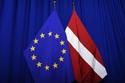 The national flag of Latvia next to the European flag © European Union, 2019