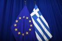 The national flag of Greece next to the European flag © European Union, 2019