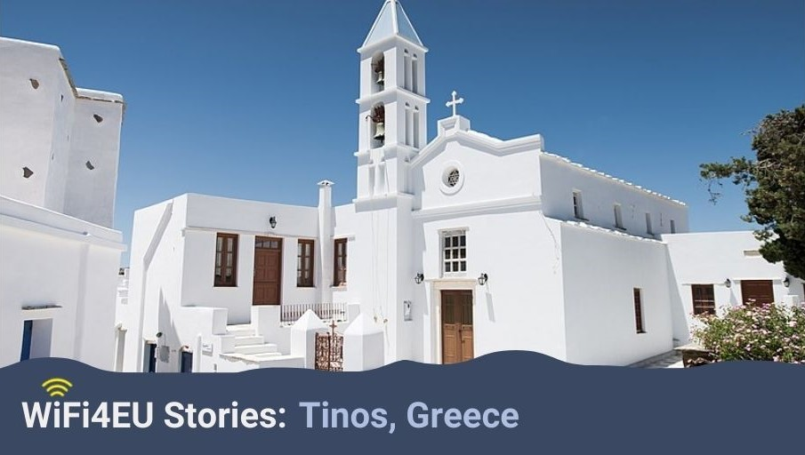 Landscape of Tinos with white buildings, WiFi4EU logo