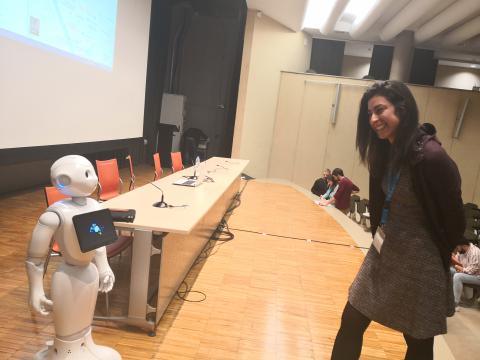 Pepper interacting with participants