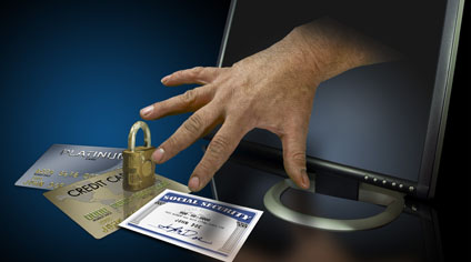 Identity theft on the web with credit cards and social security © Robert Mizerek, Fotolia
