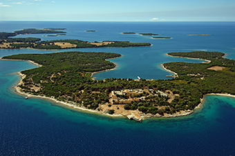 An aerial view of Mali Brijun island with the Brijuni archipelago in the background. ©Brijuni National Park