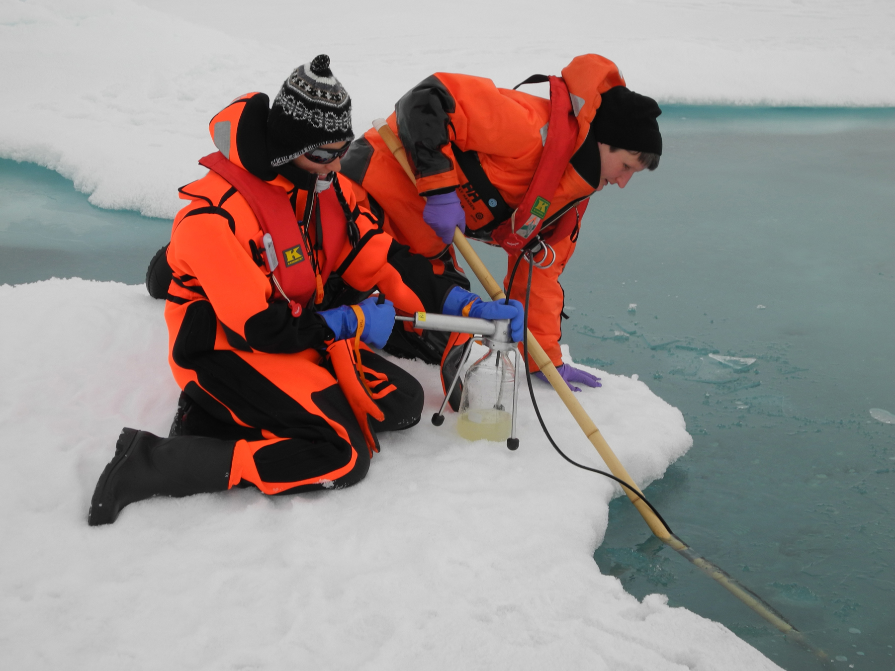 Polarstern researchers take water samples from the melting pools, the ice itself and the water beneath. They analyse all the samples for plants, animals and microorganisms. On this expedition, the researchers discovered a surprising amount of algae in the pools on the sea ice. The long-lived algae provide information to scientists on recent changes to the sea ice cover. Photo: Christiane Uhlig, AWI