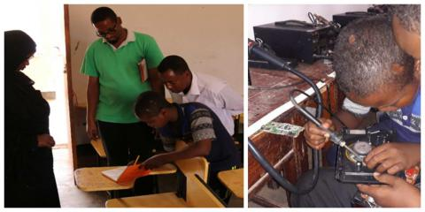 Abdullahi writing down his responses to questions asked and repairing a receiver during a practical lesson