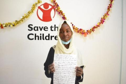 A child proudly shows her recommendations