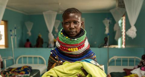 A Turkana woman poses for a photo with her new born at the Kalobeyei maternity. The maternity is accessed by refugees and Kenyans alike.