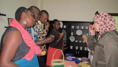 Members of the Kenyan delegation observe handmade products made by victims of trafficking as part of vocational training at the shelter