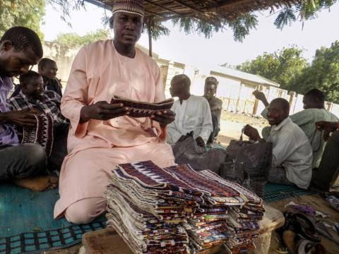 With support from the EU trust fund and NRC, Modu makes and sells caps to cater for his family in Maiduguri.