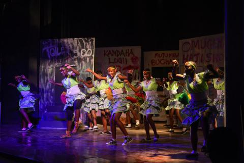 Students perform cultural dances during the competition at the national theater.