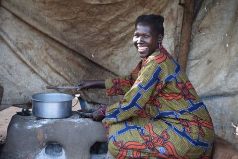 A South Sudanese woman refugee cooking in Uganda