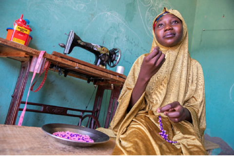 With the income from her sewing and jewelry-making businesses, Ummaima supports her family.